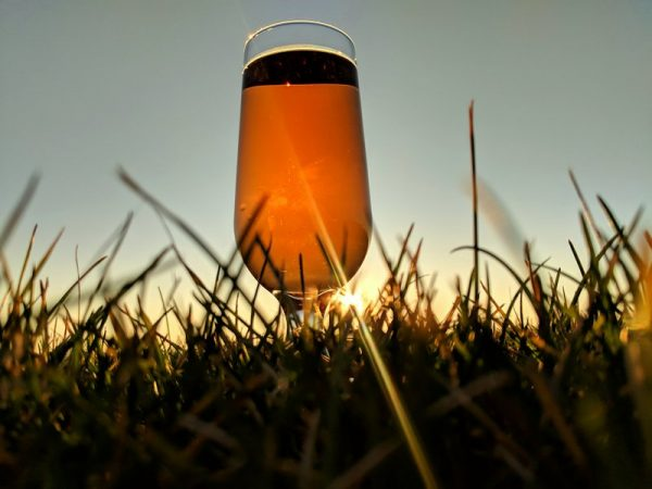 A glass of Cherry cider at sunset
