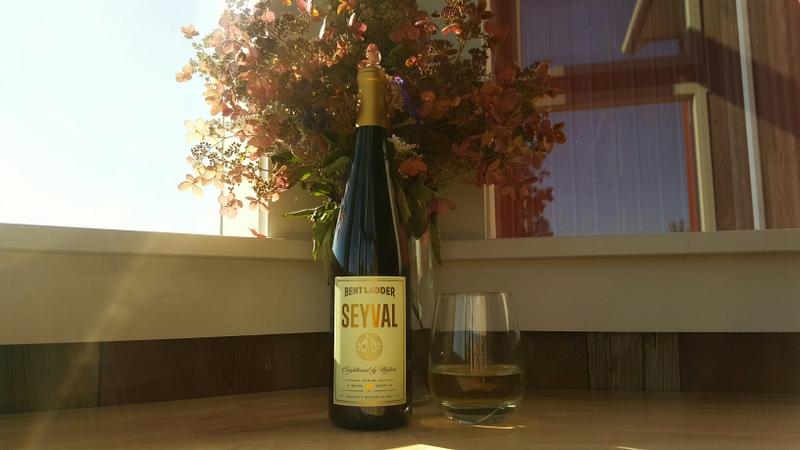 A bottle of Seyval by the window