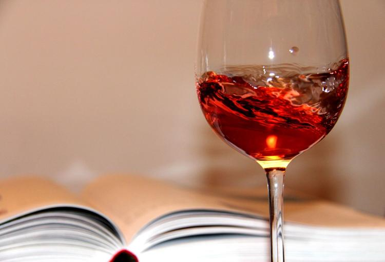 photo of a book and a glass of wine