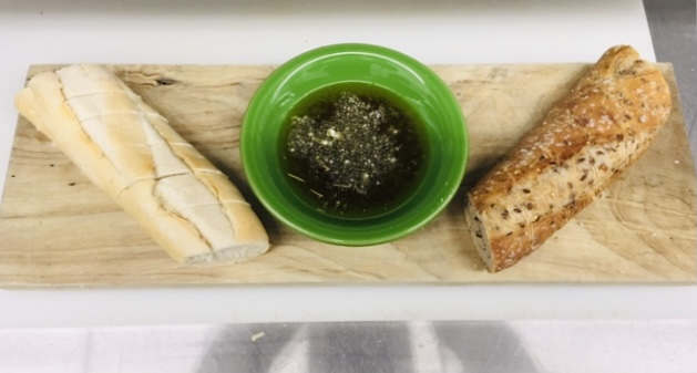 Two kinds of baguettes and our house balsamic make up our bread board